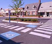 accessible parking spaces with stores in background