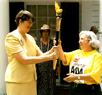 Janet Reno hands torch off to woman