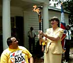 Janet Reno carries Spirit of ADA Torch