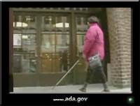 photo of a woman using a white cane