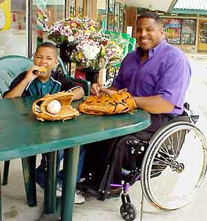 Cover Photo: man with disability and son