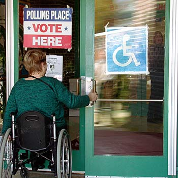 voter using wheelchair enters polling place