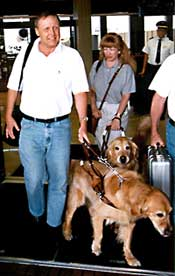Couple using guide dogs leave airport