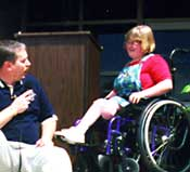 girl using wheelchair being interviewed