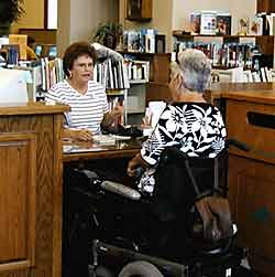 photo - woman using wheelchair at desk in library