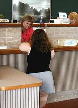 photo - woman of short stature at accessible service counter