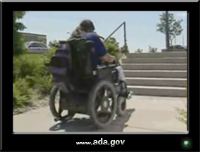 photo of a man using a power wheelchair