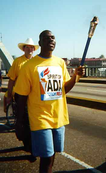 Man carries torch across Pettus Bridge