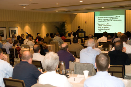 Photo of attendees listening to presentation at Access Forum.