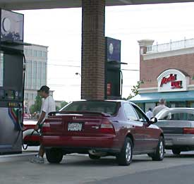 photo - man pumping self-service gas