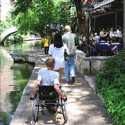photo of River Walk, pedestrians and restaurant