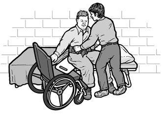 image of a shelter worker helping with a transfer to the cot