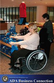 A woman in a wheelchair shops for clothes, ADA business connection logo