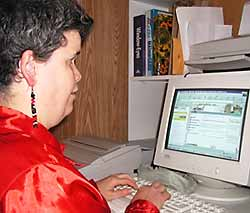 photo - woman viewing website on computer monitor