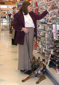 woman with service animal in store